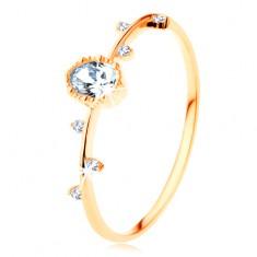 Prsten od 14K žutog zlata - prozirni oval sa zupčastim obrubom, sitni cirkoni