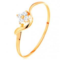 Prsten od 14K žutog zlata - proziran cirkonski cvijet, valoviti krak