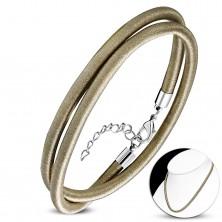 Ogrlica omotana okolo sa sjajnim navojem zlatno-smeđe boje, karabin kopča