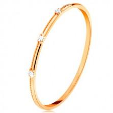 Prsten od 9K žutog zlata - tri odvojena prozirna cirkona, fini urezi