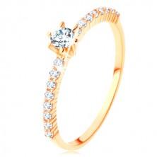 Prsten od 9K žutog zlata - prozirne cirkonske linije, izbočeni okrugli cirkon