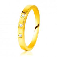585 dijamantni prsten od žutog zlata - sjajni krakovi, tri blistava brilijanta